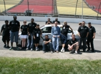 Team members with the Focus at the Track