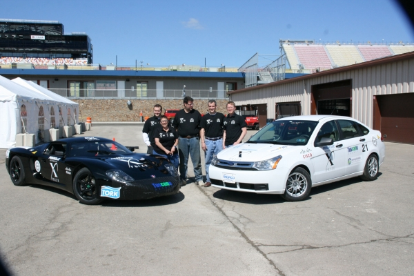 Team members with the inspected EVX Focus and GT